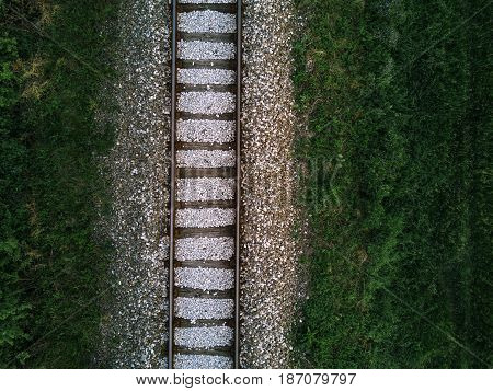 Aerial view of railway track through countryside drone top view pov of rails as abstract background