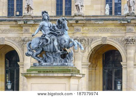 Paris France - May 1 2017: Statue of King Louis XIV in the courtyard of the Louvre Museum (Musee Du Louvre) on May 1 2017 in Paris France.