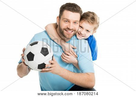 Young Father And Son Posing With Soccer Ball Isolated On White