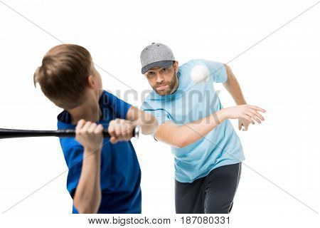 Boy Ready To Hit The Ball During A Baseball Game. Father And Child Playing Baseball Isolated On Whit