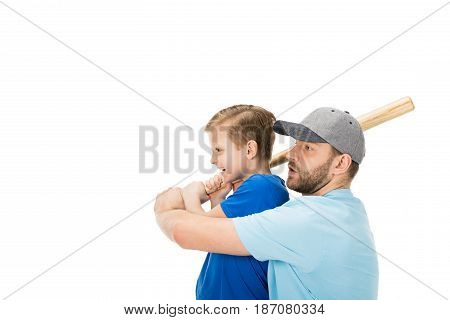 Side View Of Father Teaching His Son How To Play Baseball Isolated On White