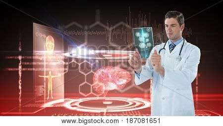 Digital composite of Digital composite image of male doctor looking at x-ray with interface graphics in background