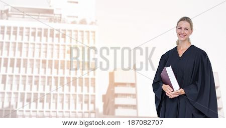 Digital composite of Portrait of smiling judge holding book in city