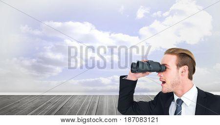 Digital composite of Digital composite image of surprised businessman using binoculars against cloudy sky