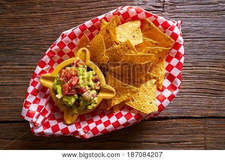 Nachos with guacamole mexican recipe on wood board