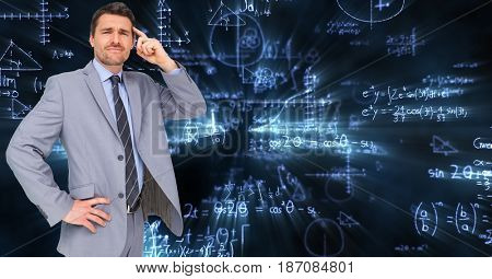 Digital composite of Confused businessman with math equations in background