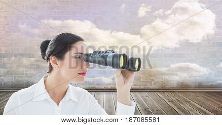 Digital composite of Digital composite image of businesswoman looking through binoculars