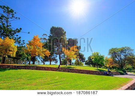 Adelaide Australia - April 14 2017: Unrecognised people riding their bicycles along Torrens river bike track in North Adelaide on a bright day