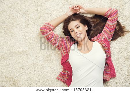 Woman Lying Down on Carpet Happy Young Adult Girl Lie on Floor Top View