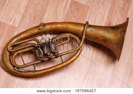 Old Rusty Alto Saxhorn On Wooden Background