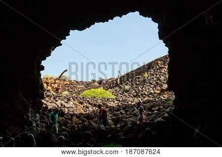 Lanzarote, Spain, March 31, 2017: People Descend Into A Cave Cueva De Los Verdes, Volcanic Cave In L