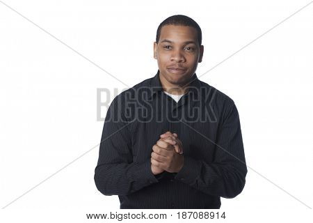 Smiling man with hands clasped