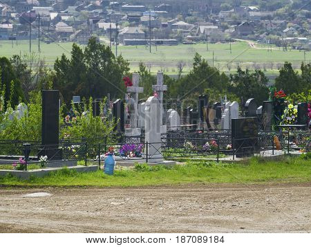 City cemetery graves and trees in the background