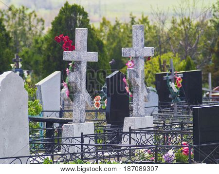 Two crosses and graves in the old cemetery