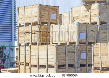 The stack of wooden crates next to the factory.