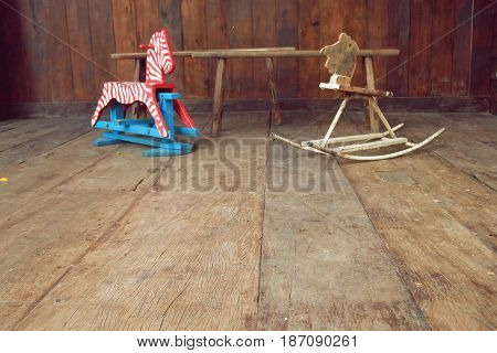 vintage rocking horse on old wood background