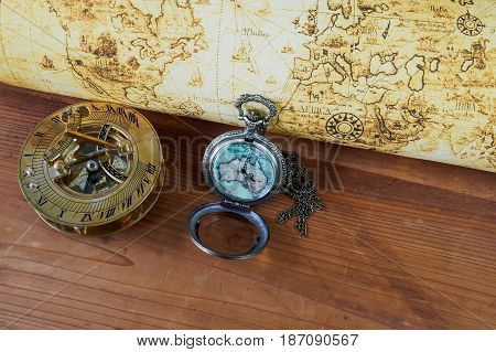 Pocket watch on vintage map. Retro style.