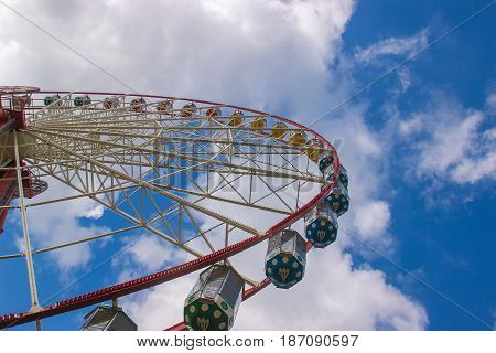 Ferris wheel on white and blue sky