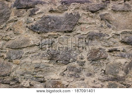 Stone pavement texture. Granite cobblestoned background at sunny day