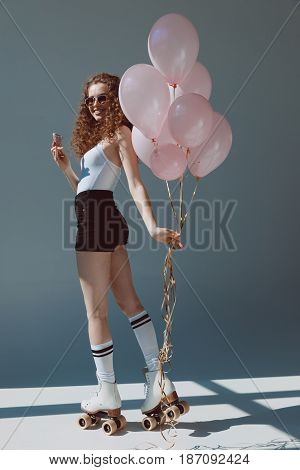 Red Hair Girl On Rollers Eating Ice Cream And Holding Air Balloons, Hipster Girl Smiling