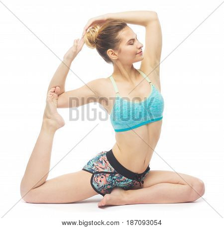 Sporty Beautiful Young Female Doing Yoga One-legged King Pigeon Pose   Eka Pada Rajakapotasana Isola
