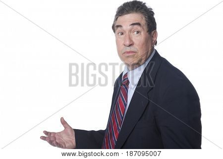 Serious businessman with arms outstretched