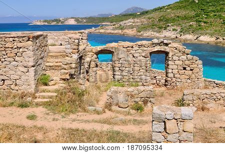 ancient ruins in Corsica island in front of turquoise sea