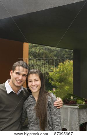 Smiling Hispanic couple hugging