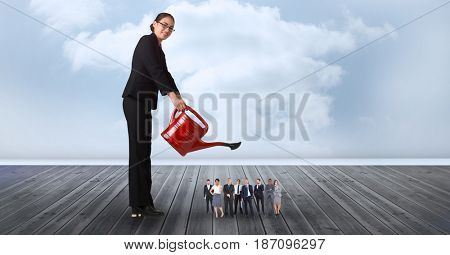 Digital composite of Smiling businesswoman watering employees on pier against cloudy sky