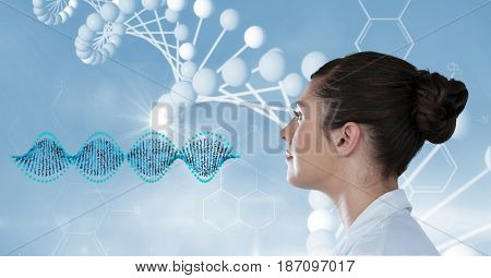 Digital composite of Female doctor looking at DNA structure