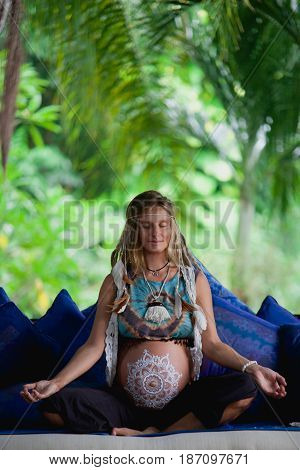 Caucasian Pregnant Woman With Dreadlocks In Boho Style. White Mehendi On Big Belly. Expectation Of B