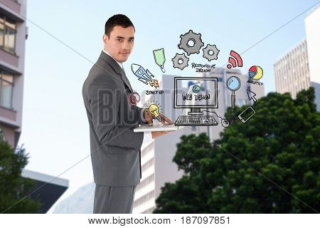 Digital composite of Confident businessman holding laptop by web design icons