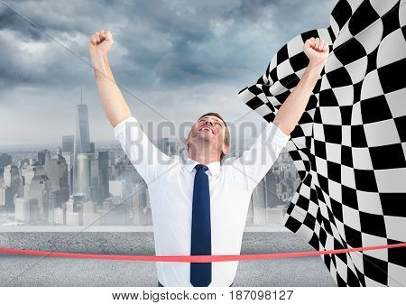 Digital composite of Business man at finish line against skyline and checkered flag