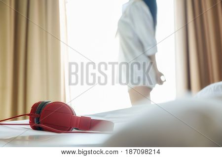 Sound music headphone (earphone) Stereo volume equipment object. Closeup photo of headphones on sofa with blurred background and copyspace area for a text. Audio technology gadgets and music concept.