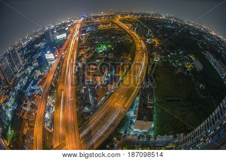 Aerial view of the express way over Bangkok city scene with city light shooting with fish eye lens.