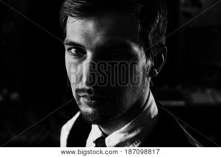 Black And White Dramatic Portrait Of A Handsome Confident Man, 30-35 Years Old. Strong Face Looking
