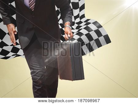 Digital composite of Business man lower body with briefcase against yellow background and checkered flag