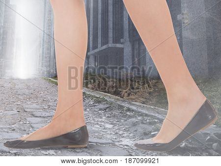 Digital composite of Womans legs Walking on path in city