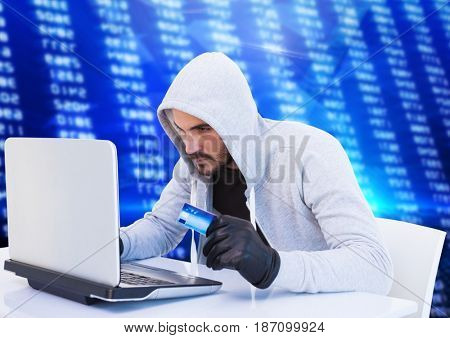 Digital composite of Criminal in hood on laptop with card in front of numbers