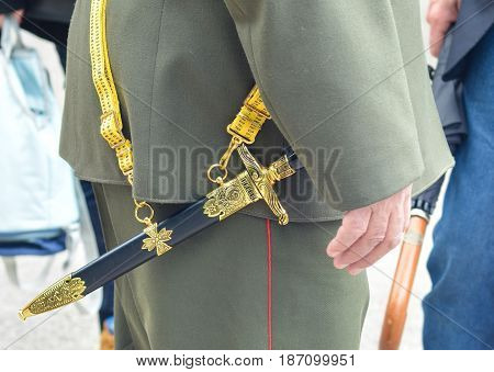 Soviet officer dagger in the hands of veteran in the second world war Military uniform