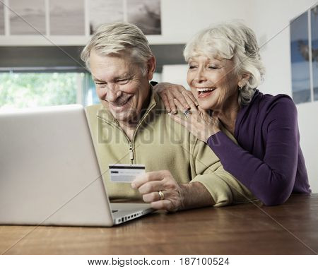 Caucasian couple shopping online with credit card