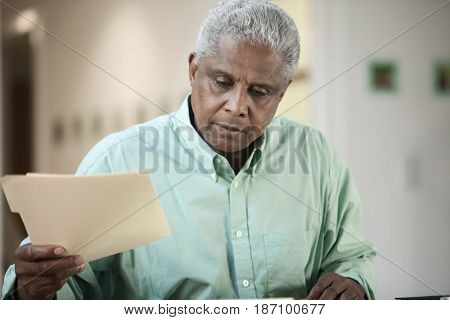 Black man holding folder