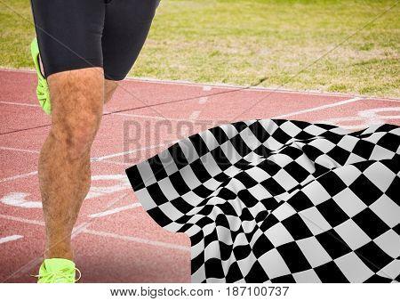 Digital composite of Male runner legs on start line with checkered flag