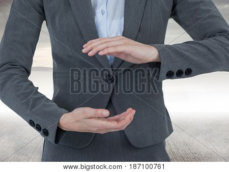 Digital composite of Businessman holding invisible object with sea background