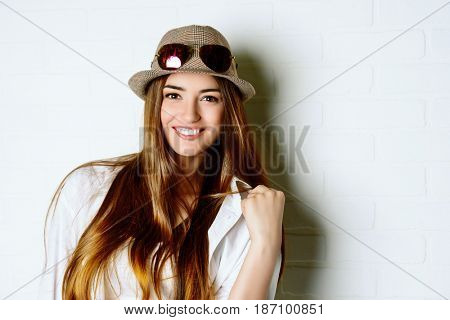 Joyful pretty young woman smiling at camera. Happy lifestyle. Beauty and youth concept.