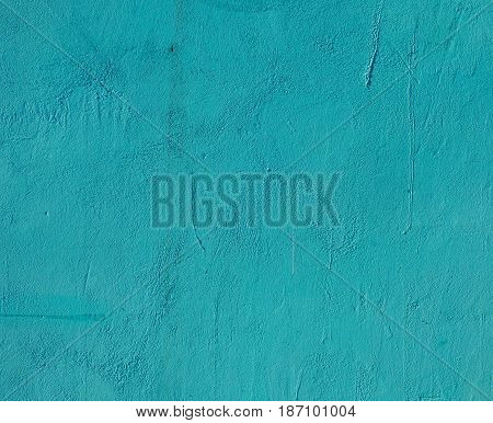 Dirty green plaster texture with lot of small cracks. Closeup view of solid surface with random structure. Industrial background with place for text.