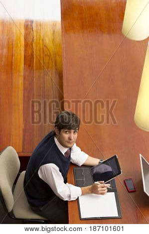 Hispanic businessman using digital tablet