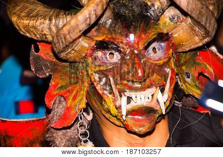 Quito, Ecuador - february 02, 2016: Close up of an unidentified man dressed up participating in the Diablada, popular town celebrations with people dressed as devils dancing in the streets.
