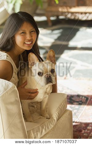 Asian woman petting dog