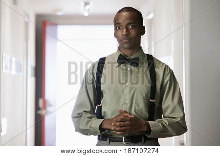 African American businessman with hands clasped